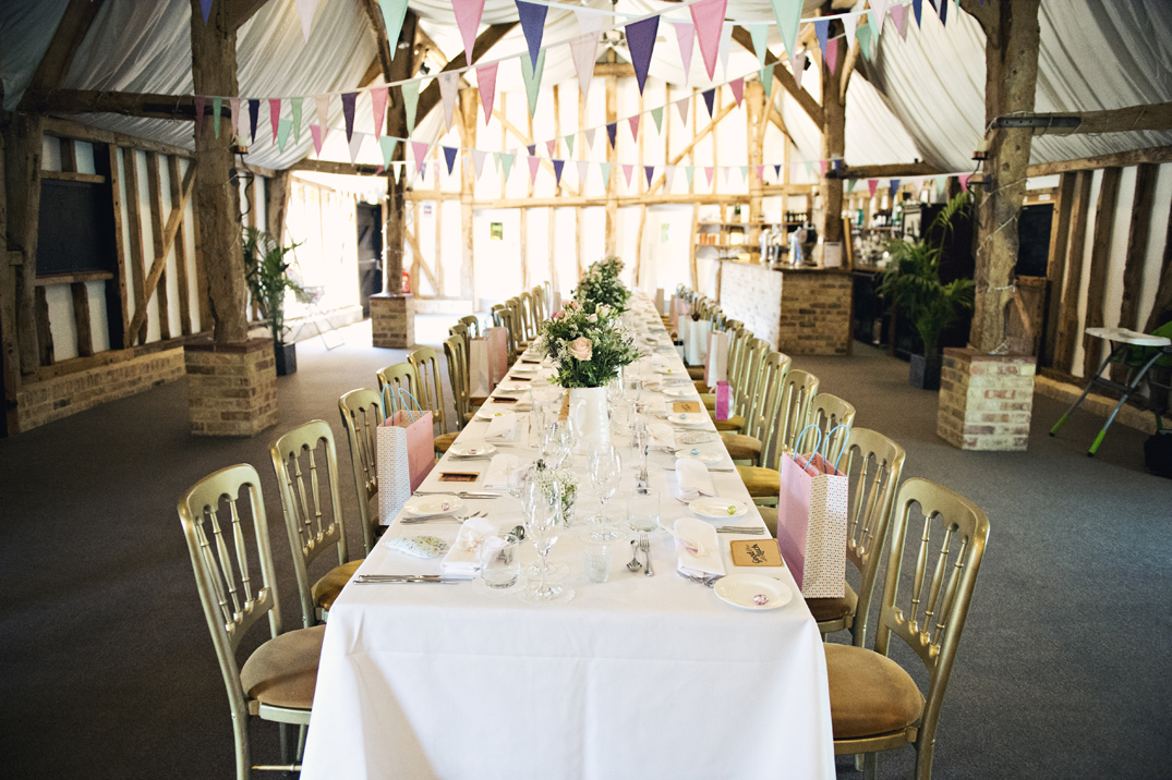 Vintage rustic pink wedding flowers table display at South Farm Cambridgeshire