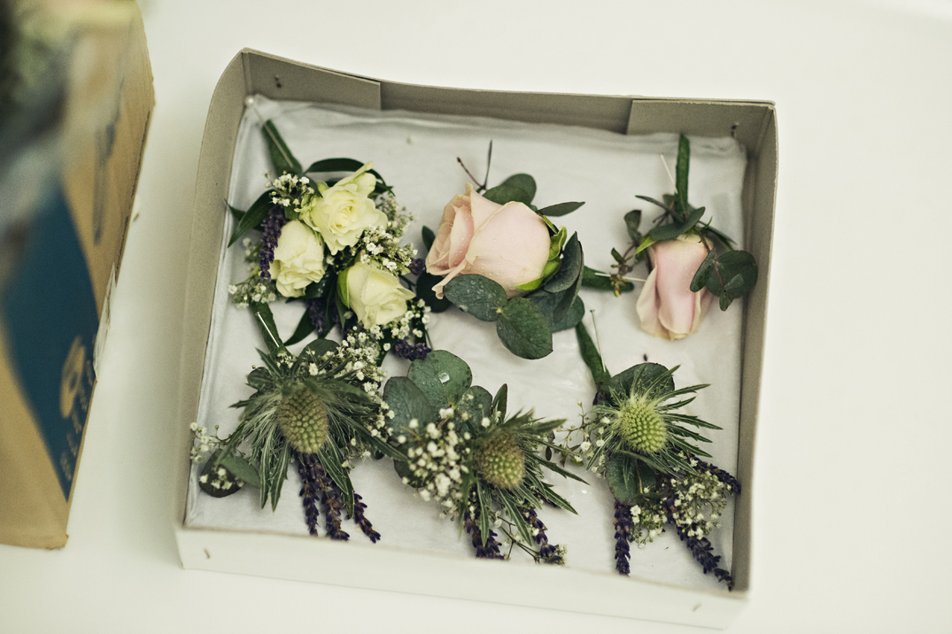 Vintage rustic pink wedding flowers buttonhoels at South Farm Cambridgeshire
