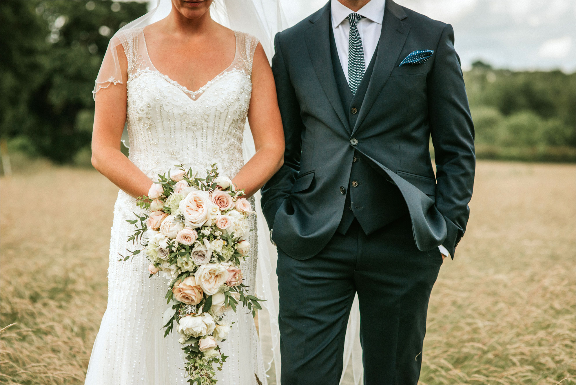 Blush grey/ or Vintage bright wedding flowers, bride bouquet and dress Theydon Garnon church Epping marquee