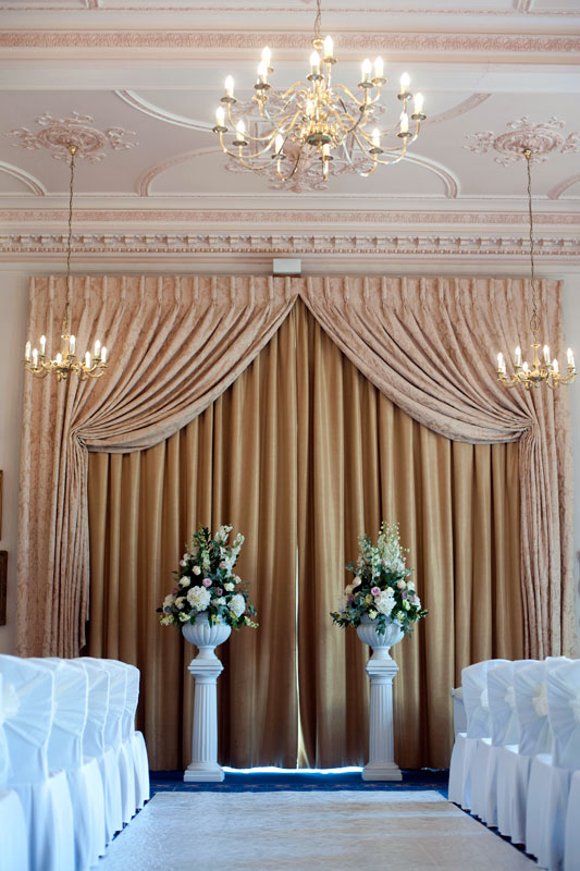Classic vintage pink wedding flowers pedestals Down Hall Hotel Essex