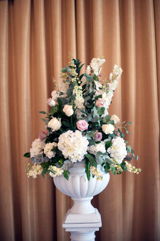 Classic vintage pink wedding flowers pedestal Down Hall Hotel Essex