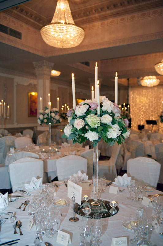 Classic vintage pink wedding flowers candelabra table display Down Hall Hotel Essex