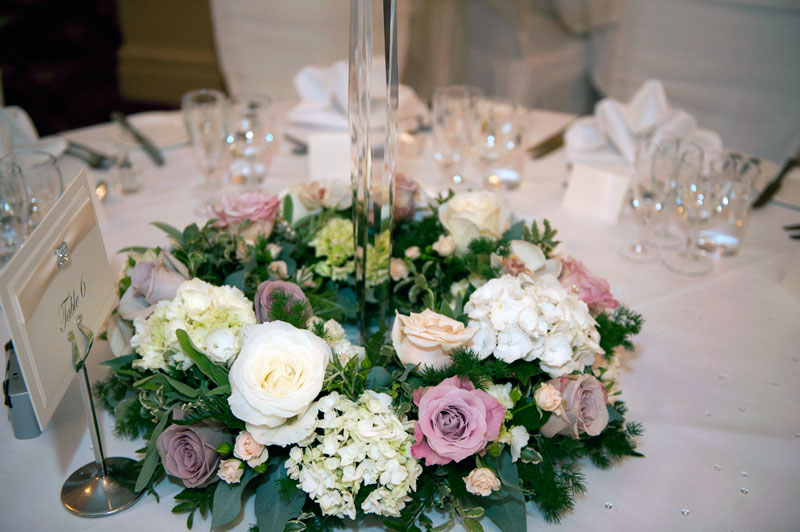 Classic vintage pink wedding flowers table display Down Hall Hotel Essex