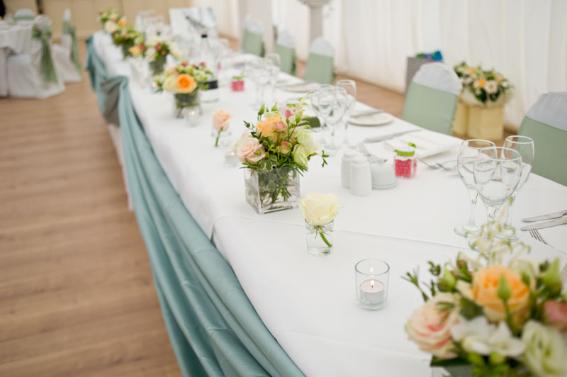 Peach and mint wedding flowers top table display Parklands Quendon Hall Essex