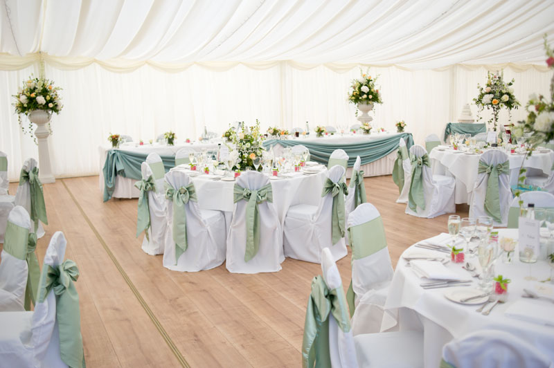 Peach and mint wedding flowers table displays Parklands Quendon Hall Essex