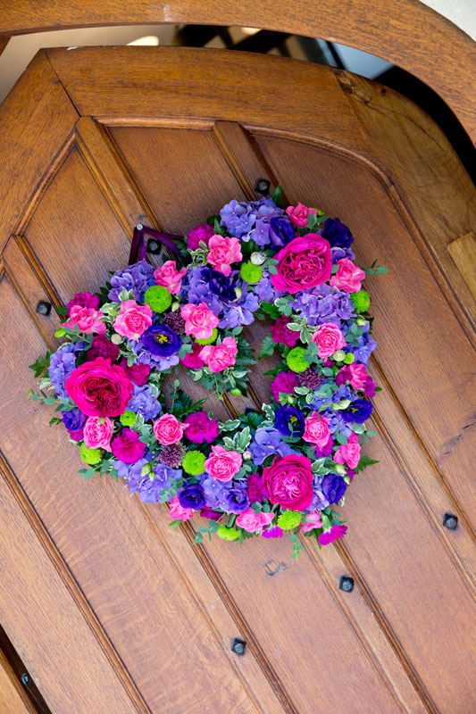 Autumn Bright Colourful Heart Wreath Wedding Flowers at Great Hallingbury Manor Essex