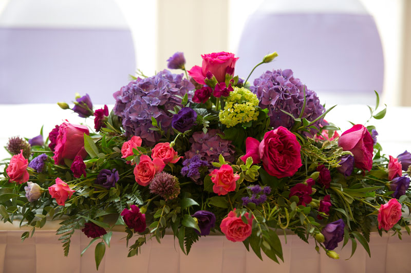 Autumn Bright Colourful top table display Wedding Flowers at Great Hallingbury Manor