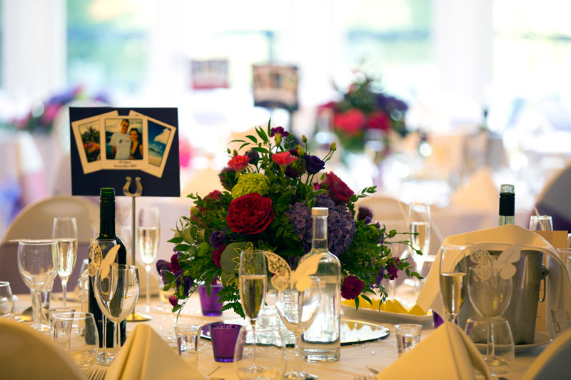 Autumn Bright Colourful Wedding Flowers table display at Great Hallingbury Manor