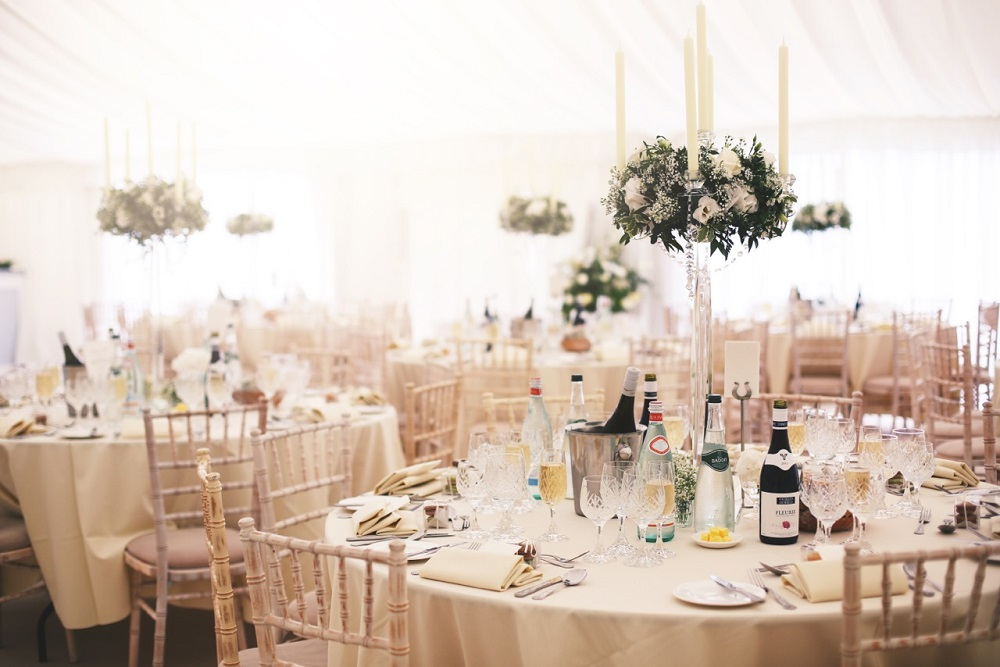 Boho chic wedding, candelabra table display bishops Stortford st michael's church wedding with marquee reception.