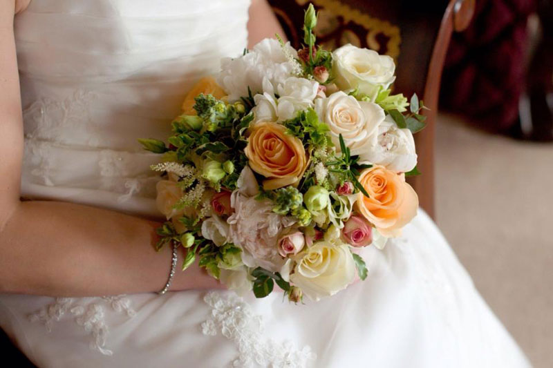 Peach and mint wedding flowers bride bouquet Parklands Quendon Hall Essex