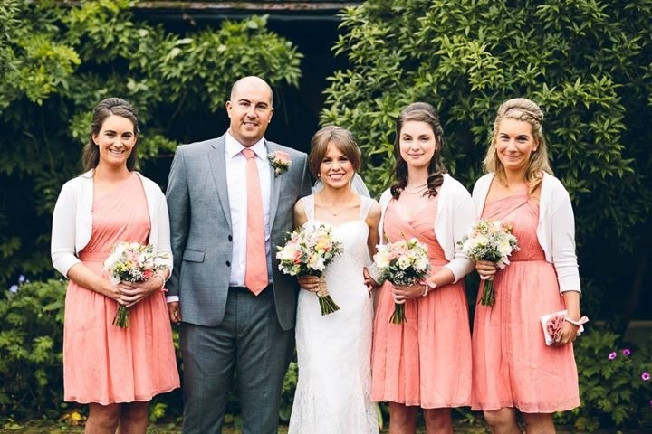 Vibrant coral pink lime and navy wedding flowers brides and bridesmaid bouquets at Manor of Groves Hertfordshire