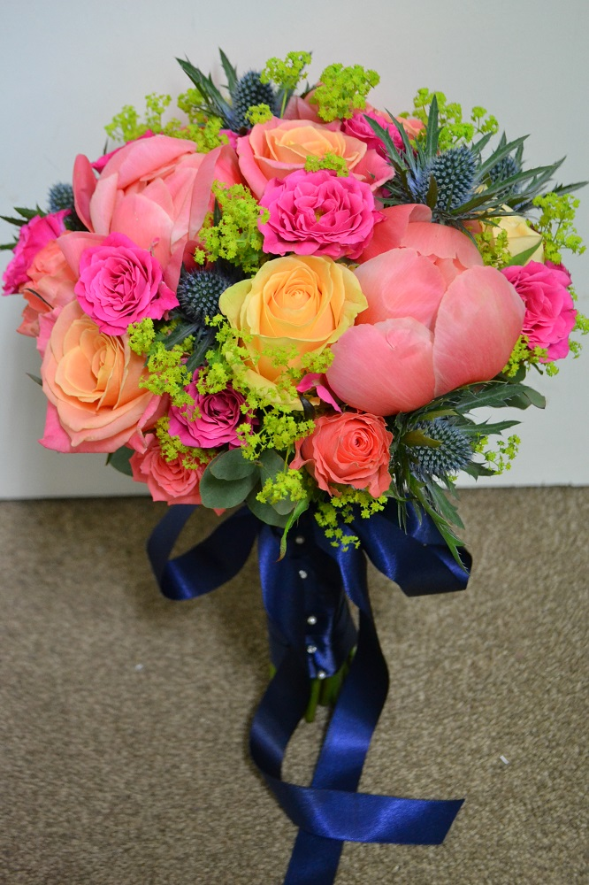 Vibrant coral pink lime and navy wedding flowers bride bouquet at Manor of Groves Hertfordshire