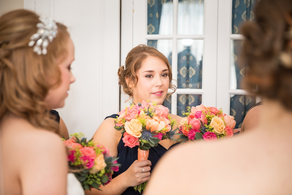 Vibrant coral pink lime and navy wedding flowers bridesmaid bouquet at Manor of Groves Hertfordshire