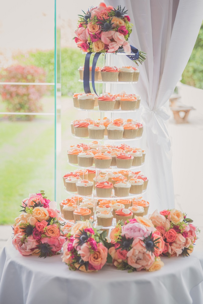 Vibrant coral pink lime and navy wedding flowers at Manor of Groves Hertfordshire