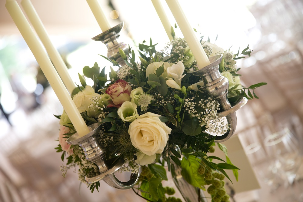 Enchanted secret garden wedding flowers candelabra table display Hertfordshire Widford Church Much Hadham Marquee