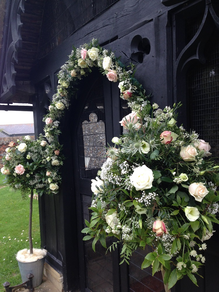 Enchanted secret garden wedding flowers, floral garland Hertfordshire Widford Church Much Hadham Marquee