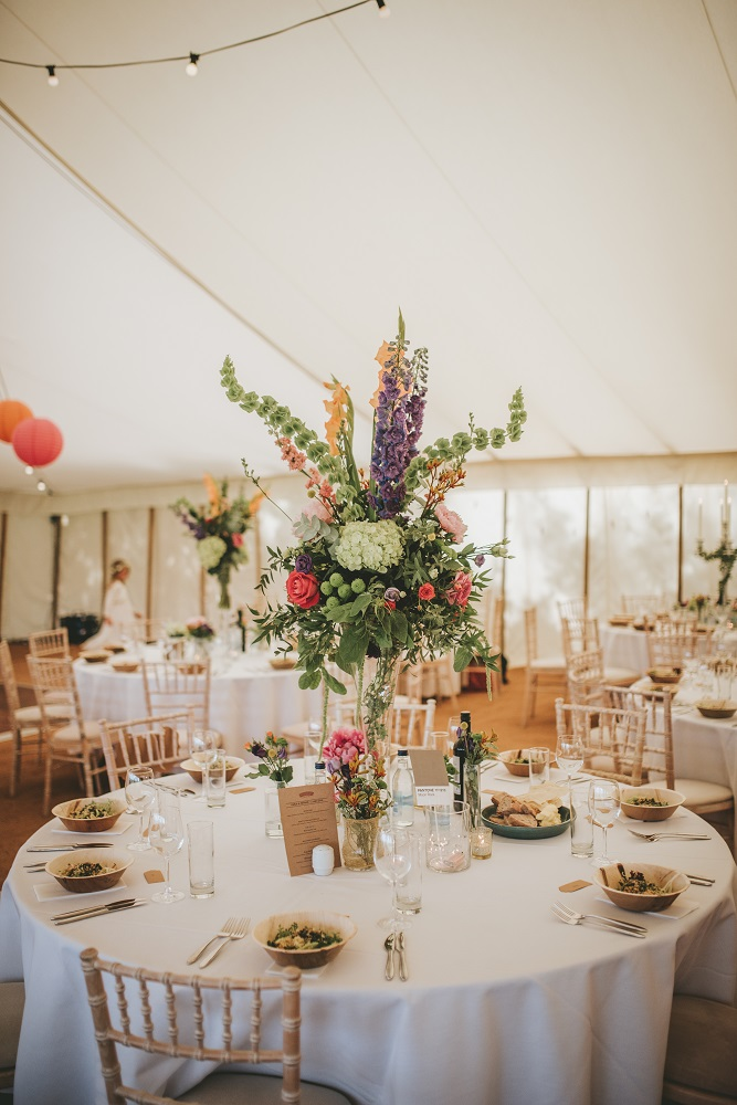 Blush grey/ or Vintage bright wedding flowers flute table display Theydon Garnon church Epping marquee