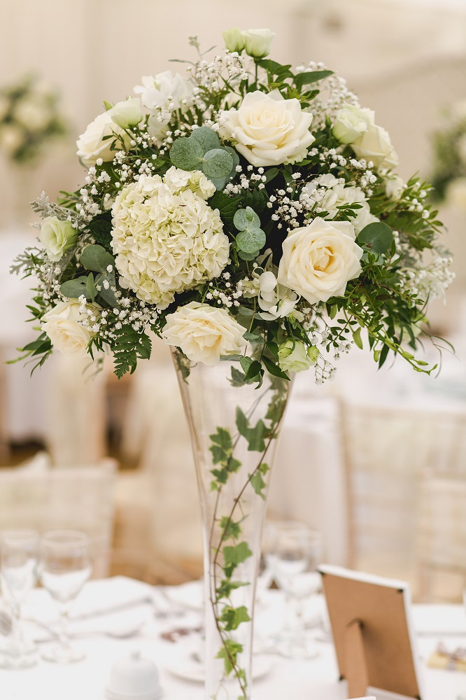 classic white green grey wedding flowers flute table display at Quendon church, Parklands, Quendon Hall, Essex, florist