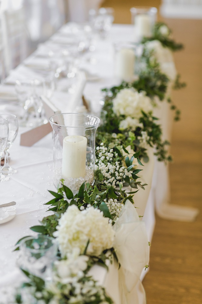 classic white green grey wedding flowers top table display at Quendon church, Parklands, Quendon Hall, Essex, florist
