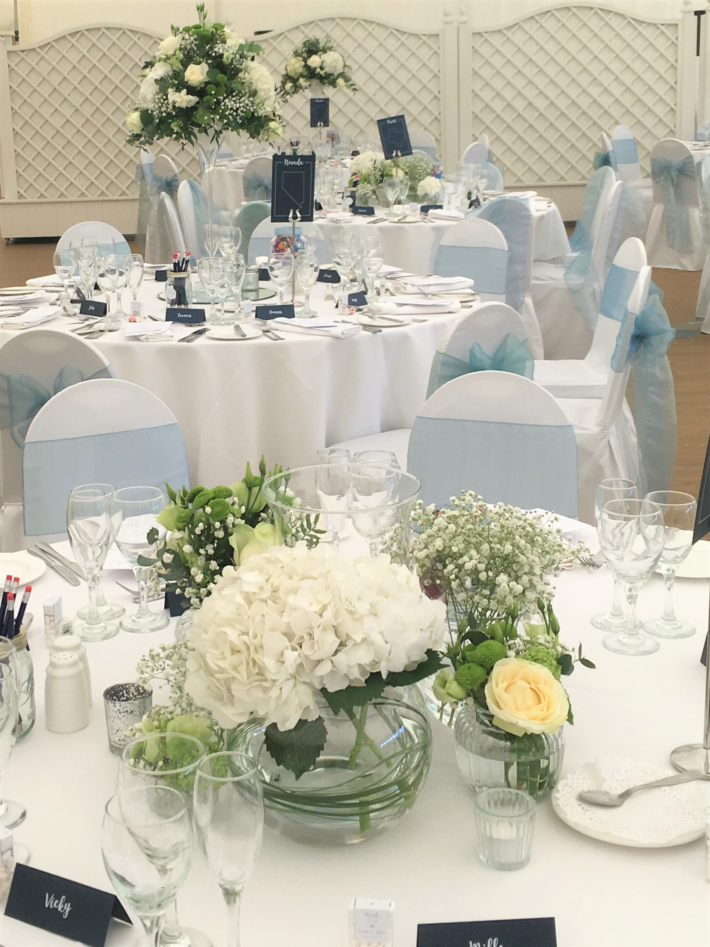 modern white green spring wedding flowers low and high table arrangements florist parklands quendon hall essex wedding venue