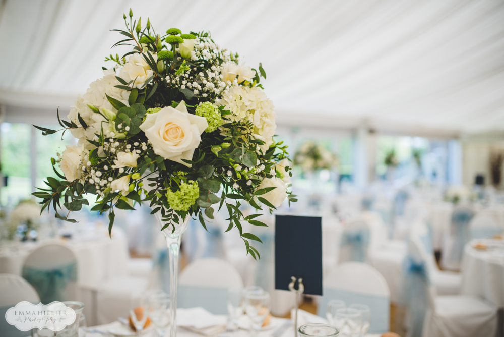 modern white green spring wedding flowers martini table display florist parklands quendon hall essex wedding venue