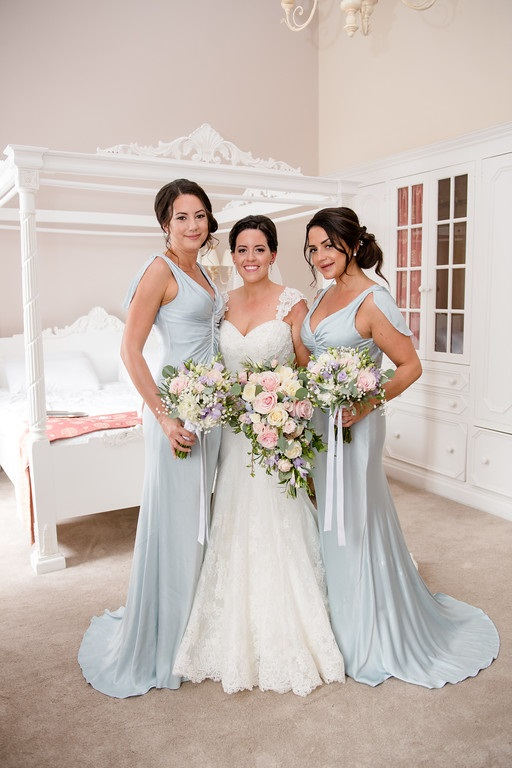 pretty pastel colours wedding flowers bride and bridesmaid bouquets florist colville hall essex wedding venue