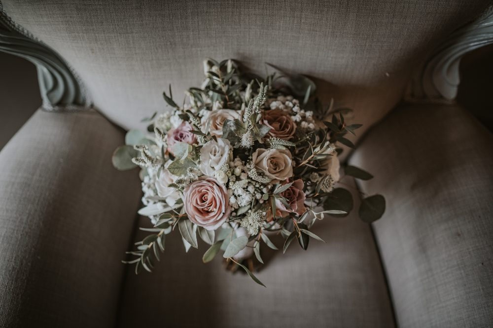 A loose, natural style bouquet with lots of eucalyptus, muted pinks and grey roses.
