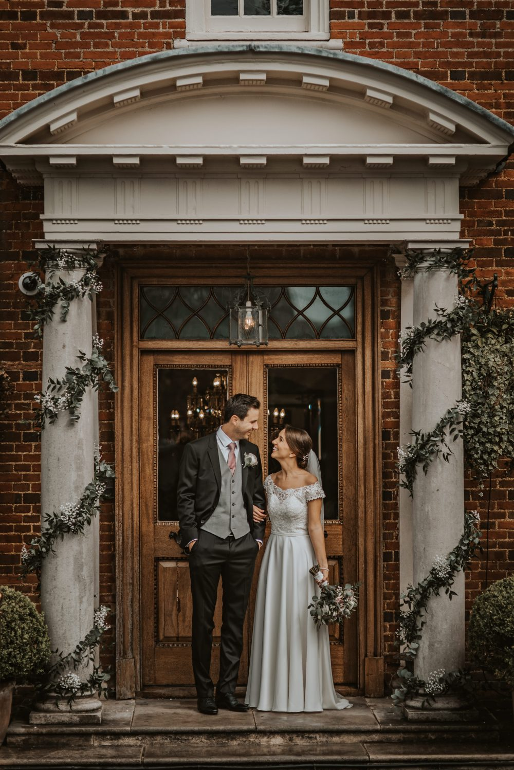 The newlyweds outside their Essex wedding venue, Quendon Hall.