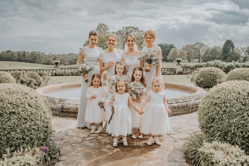Muted pink and grey bouquets and flower wands to complement the pale grey bridesmaid dresses worn at this Parklands wedding.